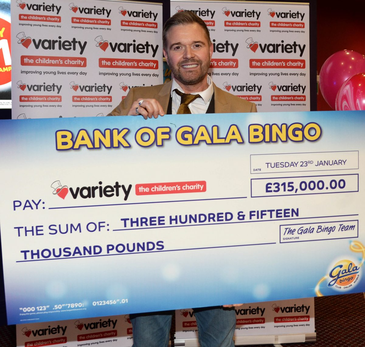 "NEWS RELEASE  Gala Bingo Birmingham presents Variety, the Children's Charity with a cheque for £315,000 along with special guest Darren Day Tues 23rd  January 2018, Birmingham  Gala Bingo has celebrated raising £315,000 since it launched its charity game nearly six months ago for Variety, the Children's Charity, at its Birmingham club today.   Gala Bingo originally aimed to raise £250,000, but due to the generosity of its staff and customers throughout the company, they exceeded this total by over £50,000. With two months left to play Gala Bingo's charity game, the estimated final total is likely to be nearer £400,000.  These fundraising efforts are part of the pledge made by The Bingo Association to raise a staggering £1 million for Variety by the end of 2018.   The money raised by the new game will be used to sponsor Variety's Sunshine Coaches, fund a number of grants for specialist, sensory and medical equipment and powered and sports wheelchairs. The funds will also go towards providing a number of memorable days and outings for disabled and disadvantaged children across the UK. The cheque was presented to Variety by television and West End theatre actor, Darren Day.   Colleen Ettridge, Head of Fundraising at Variety, the Children's Charity said:  ""We have been overwhelmed by the generosity of Gala Bingo and its customers. Since 1962, Variety has donated nearly 5,500 Sunshine Coaches to schools across the UK so we can give disabled and disadvantaged children and young people improved opportunities to get the most out of life. This donation will go a long way in helping us provide essential equipment for disabled and disadvantaged children across the UK."" Darren Day, Television and West End Theatre Actor said: ""I'm delighted to be here in Birmingham  celebrating the wonderful achievement of Gala Bingo. I know that the donation of this fantastic sum of money will make a tangible difference to children across the UK."" Simon Shaw, Chief Ret"